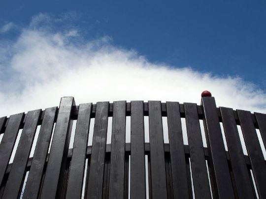 Timber fence stained with black | Caboolture